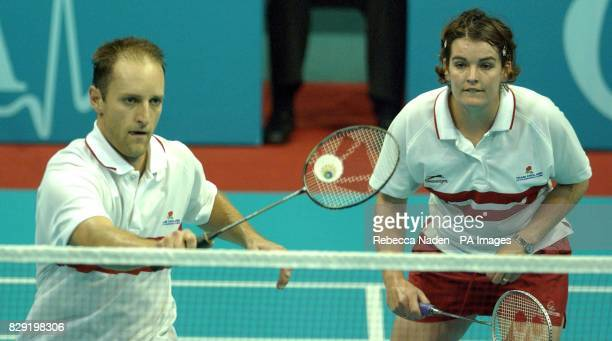England's gold winning pair of Simon Archer and Jo Goode in action during the mixed doubles final badminton at the Bolton Arena during the XVII...