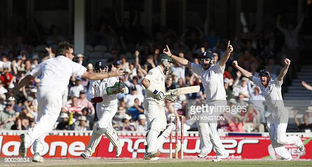 England's Graeme Swann celebrates after taking the final wicket of Australia's Michael Hussey and England win the Ashes after they win on the fourth...