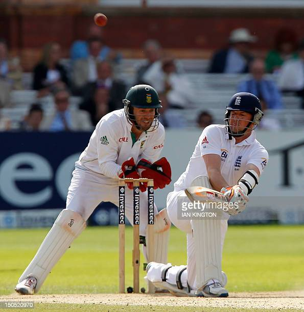 England's Graeme Swann hits a reverse sweep watched by South African wicketkeeper AB de Villiers during day 5 of the third Test match between England...