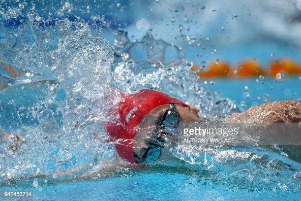 England's Guy James competes during the swimming men's 200m freestyle qualifications during the 2018 Gold Coast Commonwealth Games at the Optus...