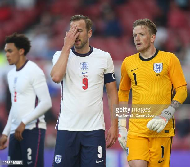 England's Harry Kane and Jordan Pickford during the international friendly match between England and Austria at Riverside Stadium on June 2, 2021 in...