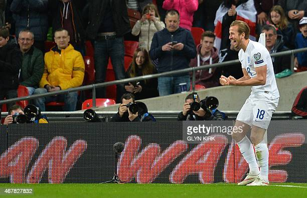 England's Harry Kane celebrates after scoring his team's fourth goal during a Euro 2016 Group E qualifying football match between England and...