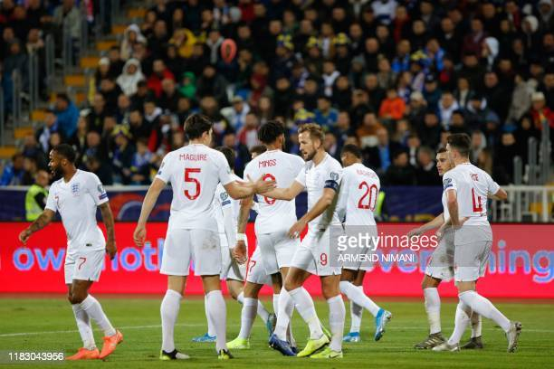 England's Harry Kane celebrates his goal with his teammates during the UEFA Euro 2020 qualifying Group A football match between Kosovo and England at...