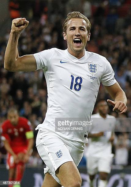England's Harry Kane celebrates scoring during the Euro 2016 qualifying group E football match between England and Switzerland at Wembley Stadium in...