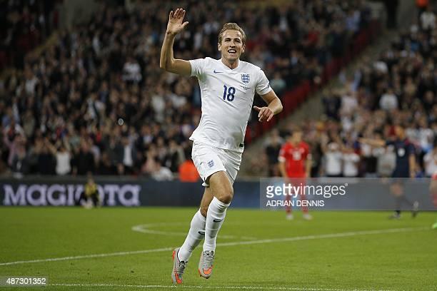 England's Harry Kane celebrates scoring during the Euro 2016 qualifying group E football match between England and Switzerland at Wembley Stadium in...