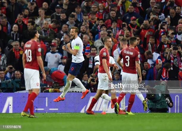England's Harry Kane celebrates scoring his side's second goal from the penalty spot during the 2020 UEFA European Championships group A qualifying...