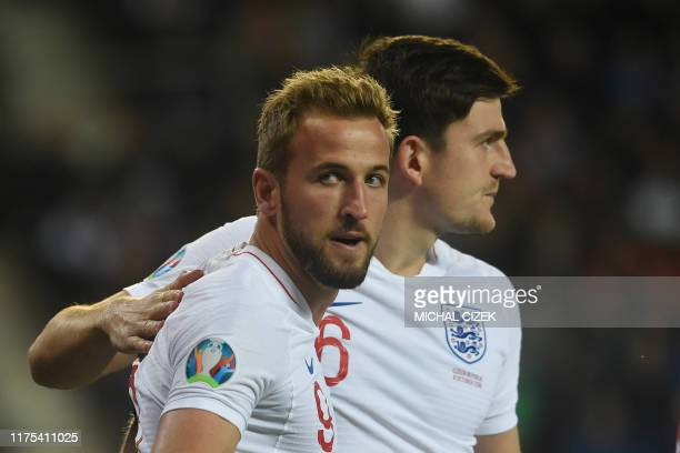 England's Harry Kane celebrates with his team mate Harry Maguire during the UEFA Euro 2020 qualifier Group A football match Czech Republic and...