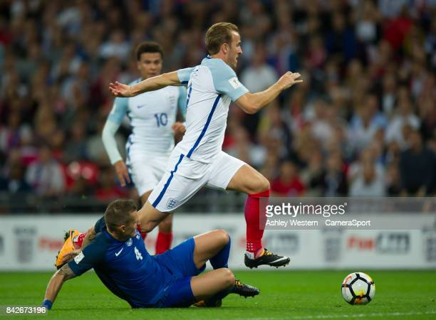 England's Harry Kane holds off the challenge from Slovakia's Jan Durica during the FIFA 2018 World Cup Qualifier between England and Slovakia at...