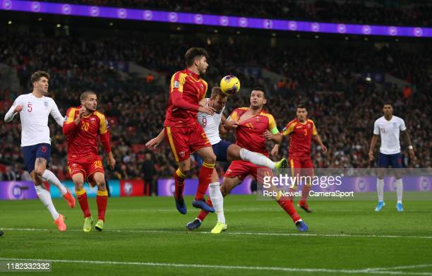 England's Harry Kane scores his side's second goal during the UEFA Euro 2020 qualifier between England and Montenegro at Wembley Stadium on November...