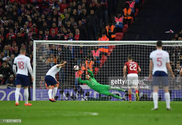 England's Harry Kane scores his side's second goal from the penalty spot during the 2020 UEFA European Championships group A qualifying match between...