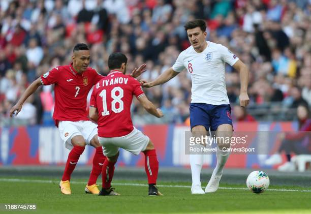 England's Harry Maguire holds off Bulgaria's Marcelinho and Galin Ivanov during the UEFA Euro 2020 qualifier match between England and Bulgaria at...