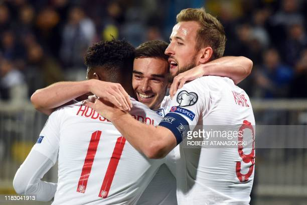 England's Harry Winks celebrates with teammates after scoring a goal during the UEFA Euro 2020 qualifying Group A football match between Kosovo and...