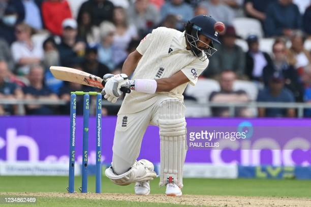 England's Haseeb Hameed avoids a delivery on the first day of the third cricket Test match between England and India at Headingley cricket ground in...