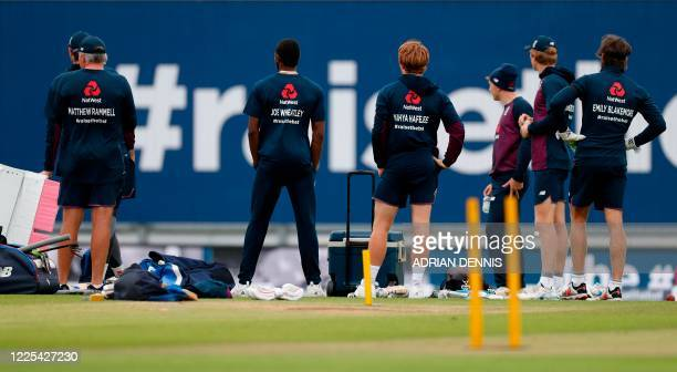 England's head coach Chris Silverwood and his players wear jumpers bearing the names of cricketplaying keyworkers and staff of Britain's NHS who have...