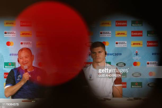 England's head coach Eddie Jones speaks beside England's centre Owen Farrell during the announcement of the team for the upcoming Japan 2019 Rugby...