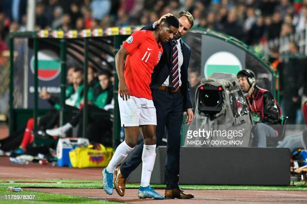 England's head coach Gareth Southgate speaks with Marcus Rashford after he left the pitch during the Euro 2020 Group A football qualification match...