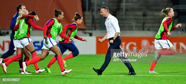 England's head coach Mark Sampson reacts after winning the UEFA Women's Euro 2017 tournament quarterfinal football match between England and France...