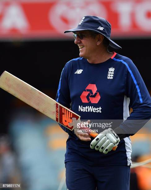 England's head coach Trevor Bayliss attends the team's warm up prior to the final day's play of the first cricket Ashes Test between England and...