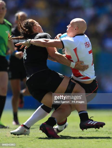 England's Heather Fisher collides with New Zealand's Niall Williams in the Women's Rugby Sevens semifinal at the Robina Stadium during day eleven of...