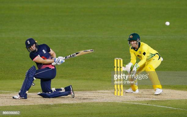 England's Heather Knight plays a shot as Alyssa Healy looks on during the Women's One Day International match between Australia and England on...
