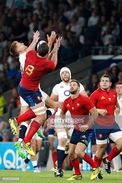 England's Henry Slade leaps for the high ball with France's Louis Picamoles during the QBE International match between England and France at...
