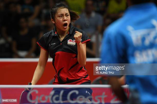 England's Ho Tin-Tin reacts as she and partner England's Liam Pitchford play against India's Manika Batra and Sathiyan Gnanasekaranserves during the...
