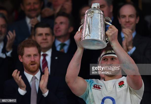 England's hooker Dylan Hartley poses with the Calcutta Cup trophy atfter winning the Six Nations international rugby union match between England and...