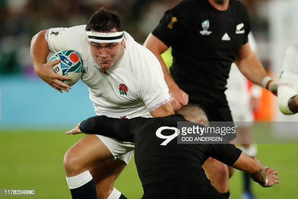 England's hooker Jamie George is tackled by New Zealand's scrum-half Aaron Smith during the Japan 2019 Rugby World Cup semi-final match between...
