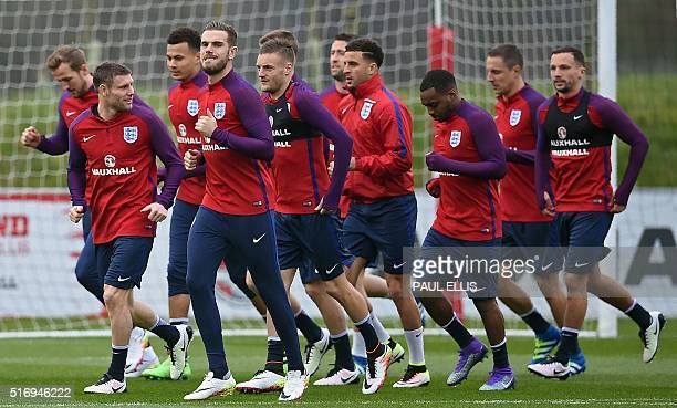 England's Hrry Kane James Milner Dele Alli Jordan Henderson and Jamie Vardy warm up with teammates during a team training session at St George's Park...