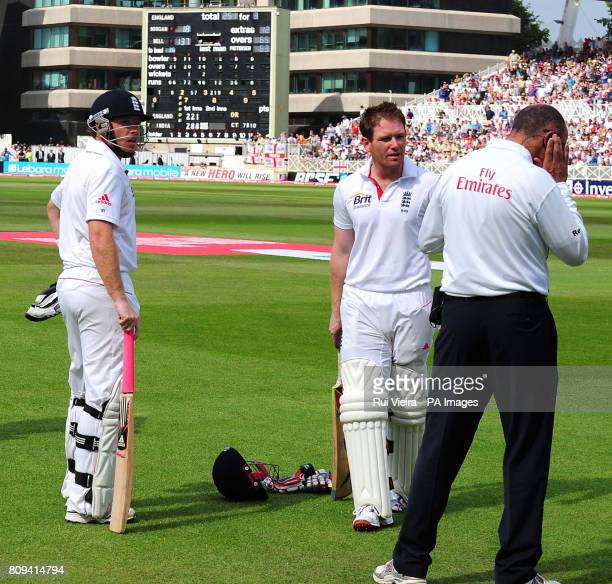 England's Ian Bell and Eoin Morgan wait for the decision on a controversial run out during the second npower test match at Trent Bridge, Nottingham.