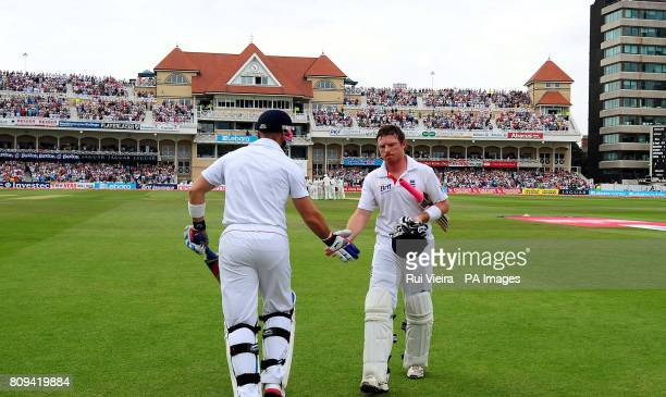 England's Ian Bell is congratulated by Matt Prior after being bowled by India's Praveen Kumar, caught MS Dhoni during the second npower test match at...