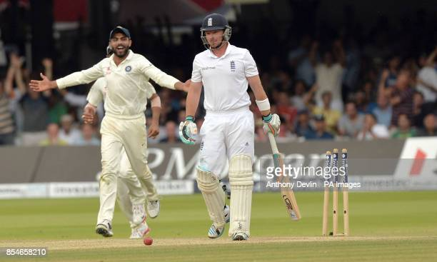 England's Ian Bell leaves the field after being bowled out by India's Ishant Sharma for 1 run during day four of the second test at Lord's Cricket...