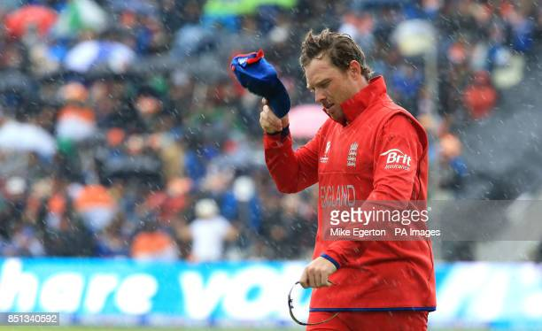 England's Ian Bell trudges off as the rain falls during the ICC Champions Trophy Final at Edgbaston Birmingham