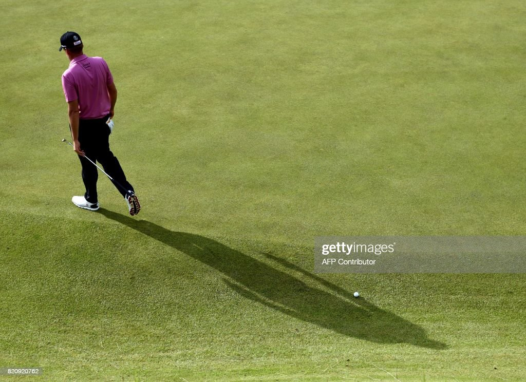 TOPSHOT - England's Ian Poulter on the 12th green during his third round on day three of the Open Golf Championship at Royal Birkdale golf course near Southport in north west England on July 22, 2017. / AFP PHOTO / Oli SCARFF / RESTRICTED
