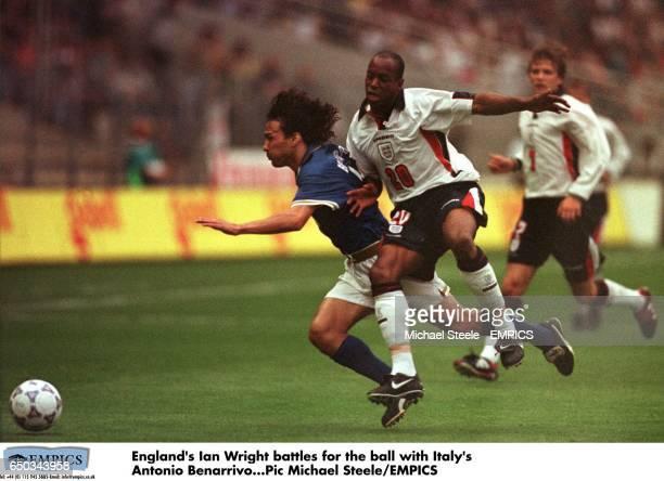 England's Ian Wright battles for the ball with Italy's Antonio Benarrivo