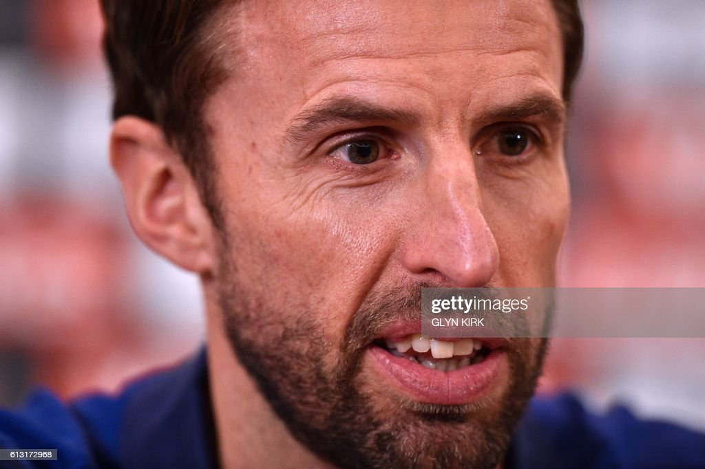 England's Interim manager Gareth Southgate answers a question during a press conference at Sopwell House hotel, north of London on October 7, 2016, ahead of England's 2018 World Cup qualifying football match against Malta on October 8. England will hope to erase the lingering stain of Sam Allardyce's embarrassing exit when interim manager Gareth Southgate takes charge for the first time in Saturday's World Cup qualifier against Malta. / AFP / Glyn KIRK / NOT
