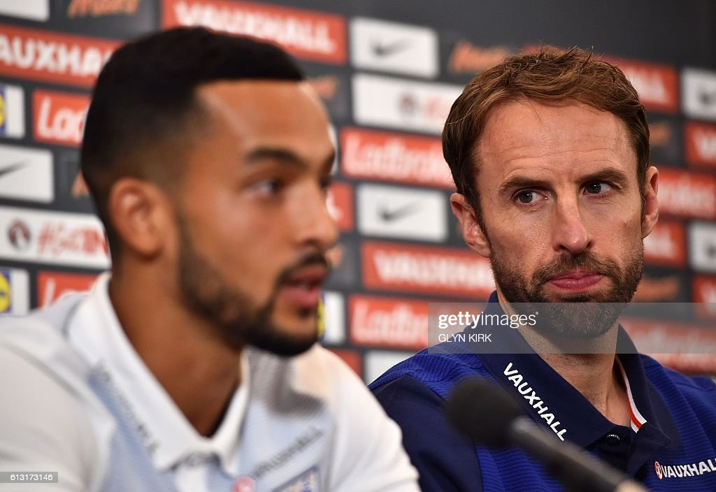 England's Interim manager Gareth Southgate (R) looks over as England's striker Theo Walcott (L) answers a question during a press conference at Sopwell House hotel, north of London on October 7, 2016, ahead of England's 2018 World Cup qualifying football match against Malta on October 8. England will hope to erase the lingering stain of Sam Allardyce's embarrassing exit when interim manager Gareth Southgate takes charge for the first time in Saturday's World Cup qualifier against Malta. / AFP / Glyn KIRK / NOT