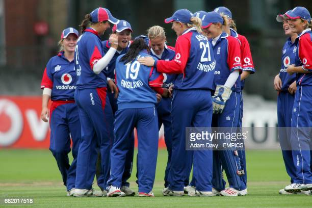 England's Isa Guha celebrates with her team mates after she caught out India's Anjum Chopra
