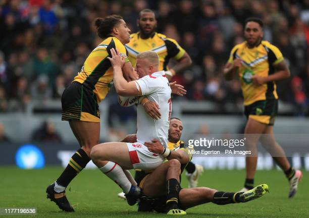 England's Jack Ashworth is tackled by Jamaica's Joel Farrell during the International Friendly match at Emerald Headingley Stadium Leeds