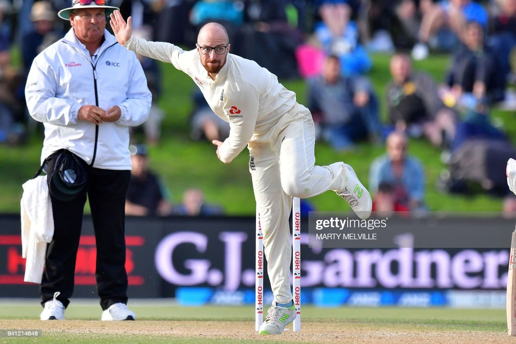 England's Jack Leach bowls during day five of the second cricket Test match between New Zealand and England at Hagley Oval in Christchurch on April 3, 2018. / AFP PHOTO / Marty MELVILLE
