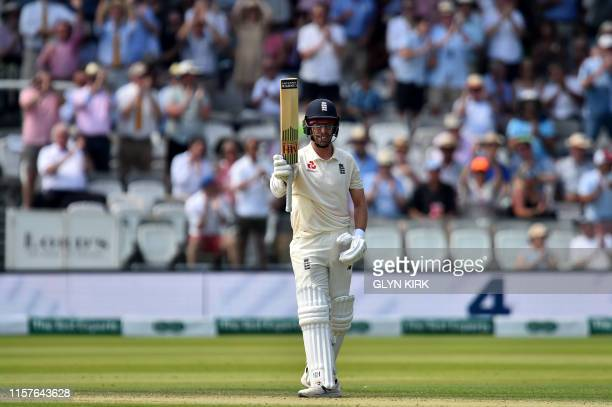 England's Jack Leach celebrates his half century on the second day of the first cricket Test match between England and Ireland at Lord's cricket...