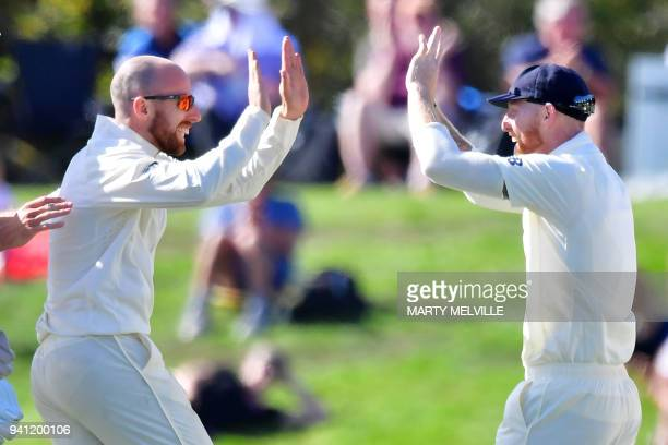 England's Jack Leach celebrates New Zealand's Tom Latham being caught with teammate Ben Stokes during day five of the second cricket Test match...
