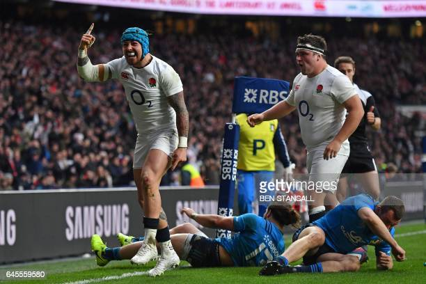 England's Jack Nowell celebrates after scoring his first try during the Six Nations international rugby union match between England and Italy at...