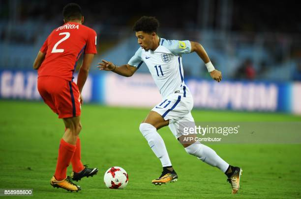 England's Jadon Sancho and Chile's Gaston Zuniga fight for the ball during the group stage football match between England and Chile in the FIFA U17...