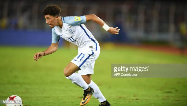 England's Jadon Sancho runs with the ball during the group stage football match between England and Chile in the FIFA U17 World Cup at the Salt Lake...