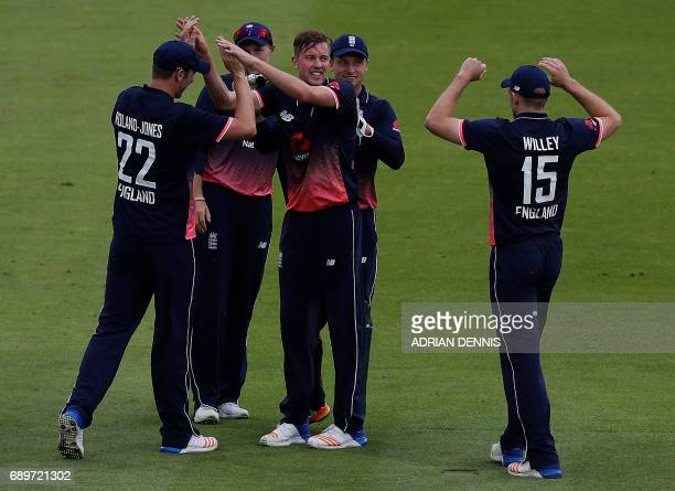 England's Jake Ball celebrates with team mates after taking the wicket of South Africa's Faf du Plessis for 5 runs to a catch by England's Jos...