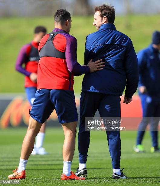England's Jake Livermore and England Manager Gareth Southgate during a training session at St George's Park Burton