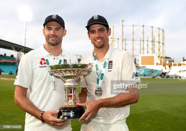 England's James Anderson and Alastair Cook pose with the Pataudi Trophy after the series win after the 5th Specsavers Test Match between England and...