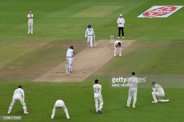 England's James Anderson and England fielders react after a dropped catch on the third day of the third Test cricket match between England and...