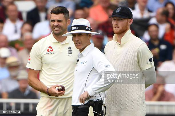 England's James Anderson and England's Ben Stokes speak to the umpire during the third day of the third Test cricket match between England and India...